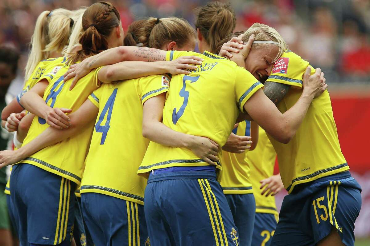 In this June 8, 2015, file photo, Sweden's Nilla Fischer (5) celebrates with her team after scoring against Nigeria during the first half of a FIFA Women's World Cup soccer match in Winnipeg, Manitoba, Canada. Sweden drew Group D, the so-called Group of Death, with the United States, Australia and Nigeria. The path certainly doesn't get any easier for coach Pia Sundhage's fifth-ranked team, who will face top-ranked Germany to open the knockout stage at the Women's World Cup.