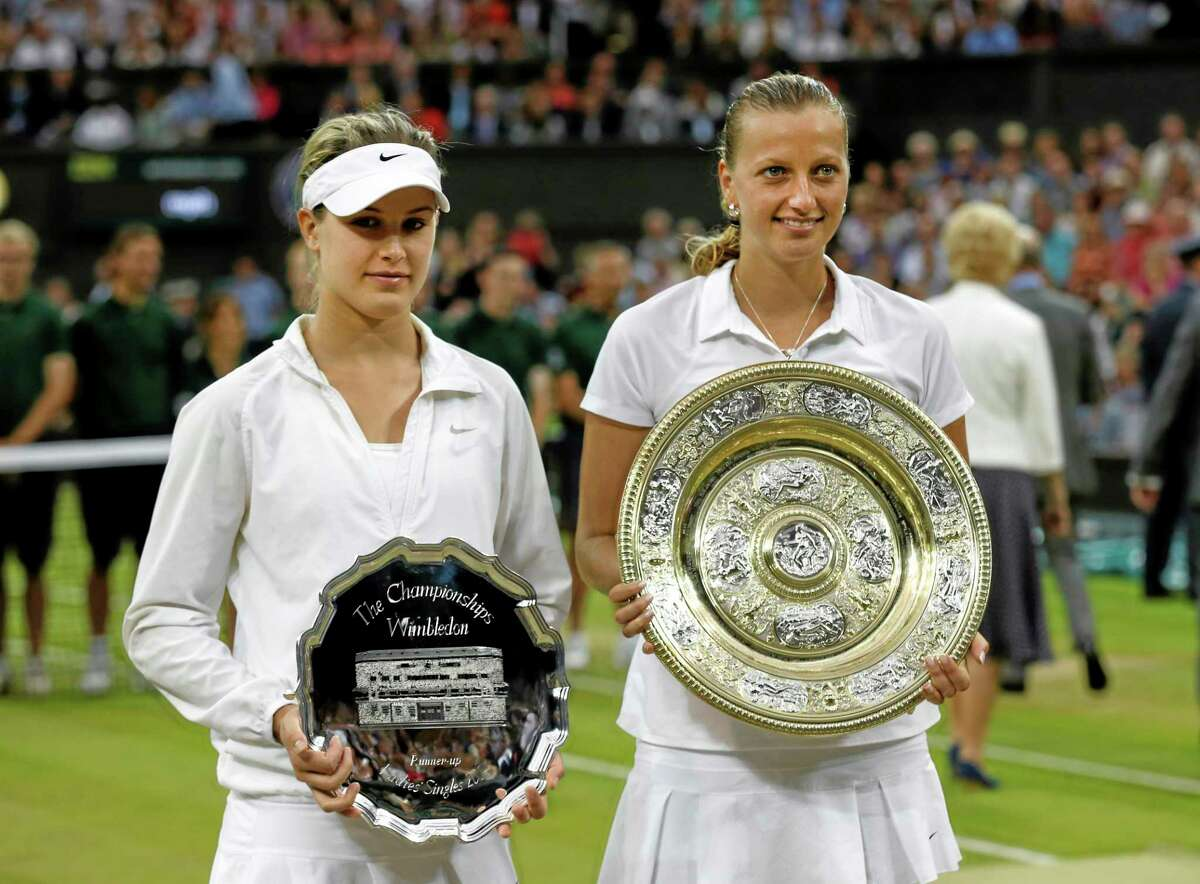 Petra Kvitova, right, holds the trophy after winning the women's final against Eugenie Bouchard, left, on Saturday at the All England Lawn Tennis Championships in Wimbledon, London. Both players will be in the field for next month's Connecticut Open at the Connecticut Tennis Center at Yale.