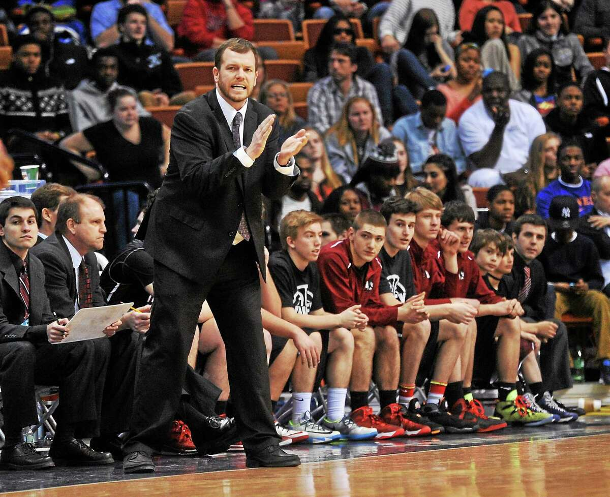 Valley Regional head coach Kevin Woods cheers on his team during the Class S title game against Sacred Heart on Sunday.