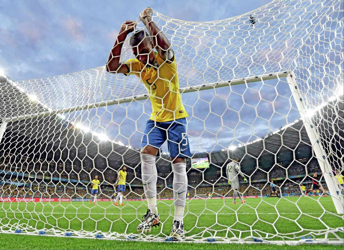 Brazil's Fernandinho reacts after Germany's Toni Kroosduring scored his side's third goal during the World Cup semifinals Tuesday at the Mineirao Stadium in Belo Horizonte, Brazil. Germany won 7-1.