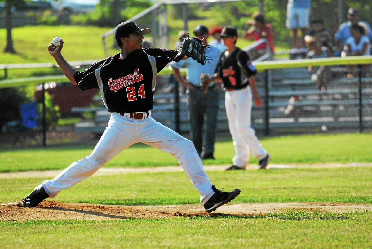 Cromwell pitcher Emilio Acosta delivers the pitch against Old Saybrook in the Little League District semifinals.