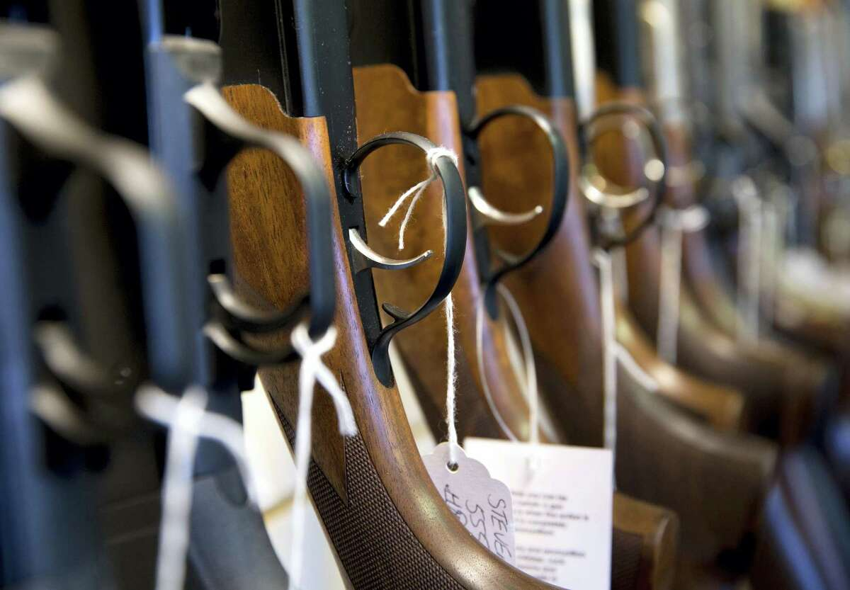 ADVANCE FOR SUNDAY DEC. 27 - This Tuesday, Dec. 15, 2015 photo shows guns Atlantic Outdoors in Stokesdale, N.C. Locally and across the nation, gun sales are spiking as the country continues to reel from repeated mass shooting in recent years. (Lynn Hey/News & Record via AP) MANDATORY CREDIT