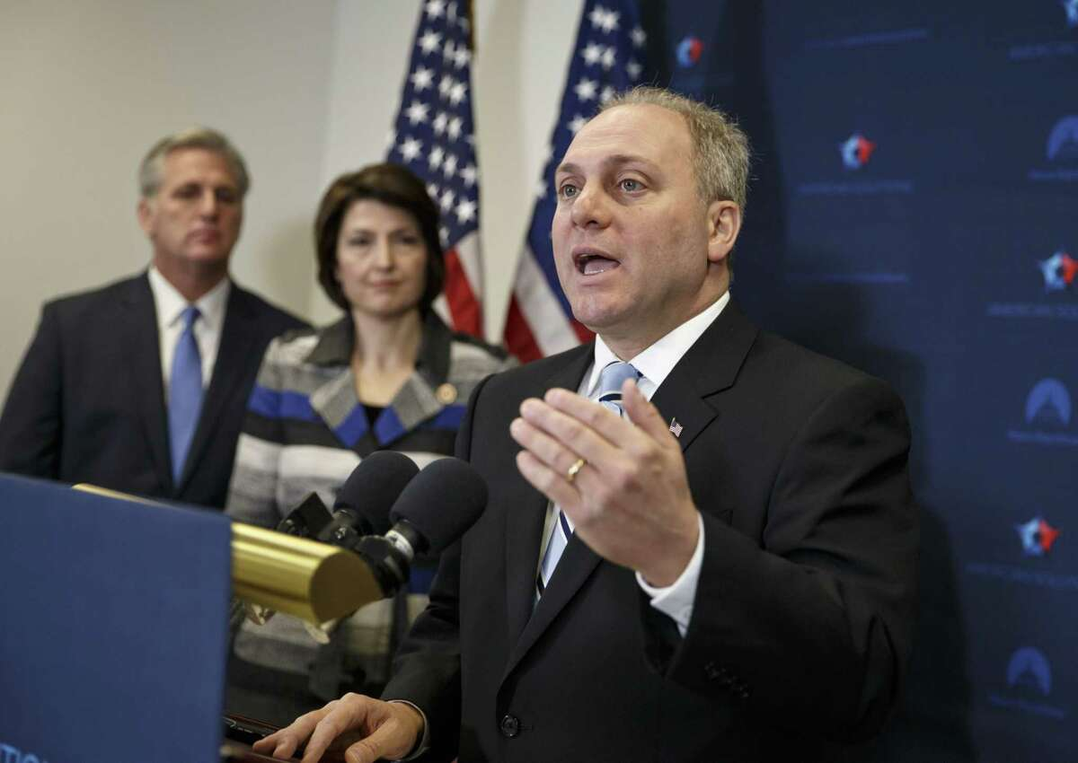 In this Nov. 18, 2014 photo, House Majority Whip Steve Scalise of La., right, with House Majority Leader Kevin McCarthy of Calif., left, and Rep. Cathy McMorris Rodgers, R-Wash., speaks to reporters on Capitol Hill in Washington, following a House GOP caucus meeting.