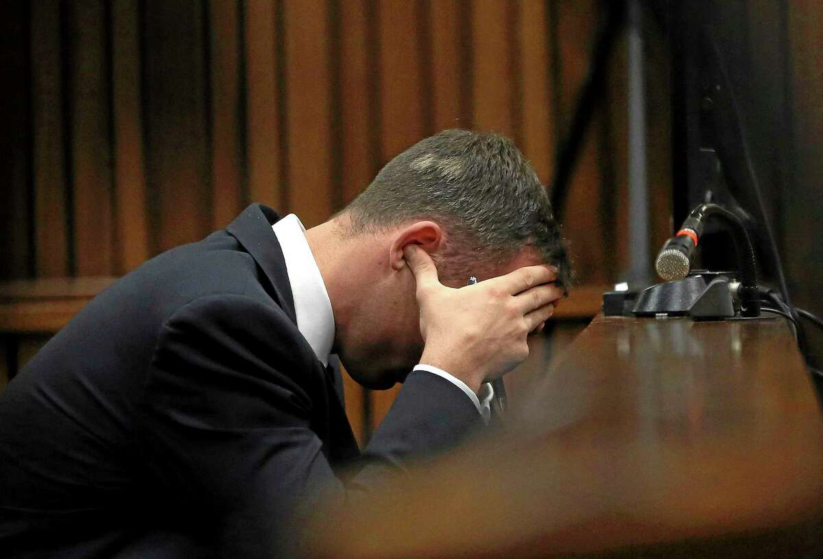 Oscar Pistorius holds his head in his hands during the testimony of a ballistics expert last week.