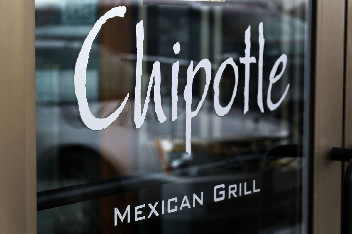 This Tuesday, Jan. 28, file photo shows the door of a Chipotle Mexican Grill in Robinson Township, Pa. Chipotle on April 27 said it has completed phasing out genetically modified ingredients from its food, making it the first national fast-food chain to do so.