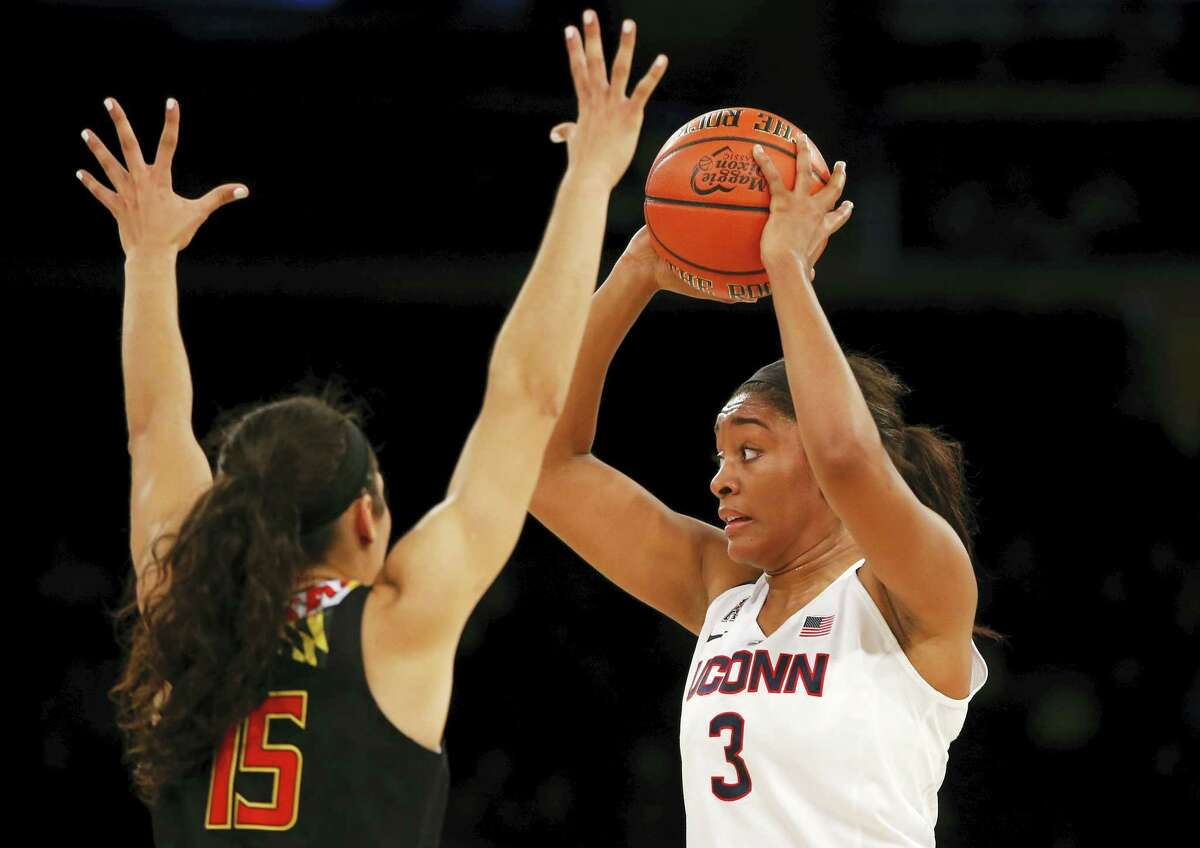UConn forward Morgan Tuck, right, looks to pass as Maryland's Chloe Pavlech defends during Monday night's game in New York.