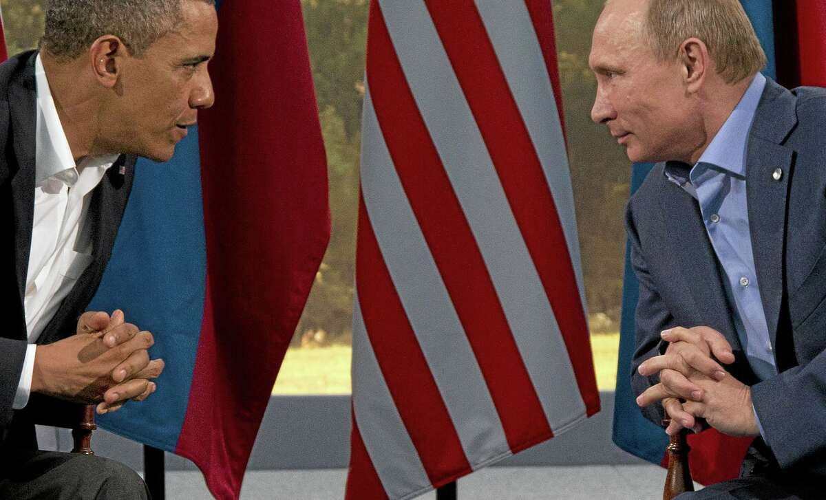This 2013 photo shows President Barack Obama meeting with Russian President Vladimir Putin in Enniskillen, Northern Ireland.