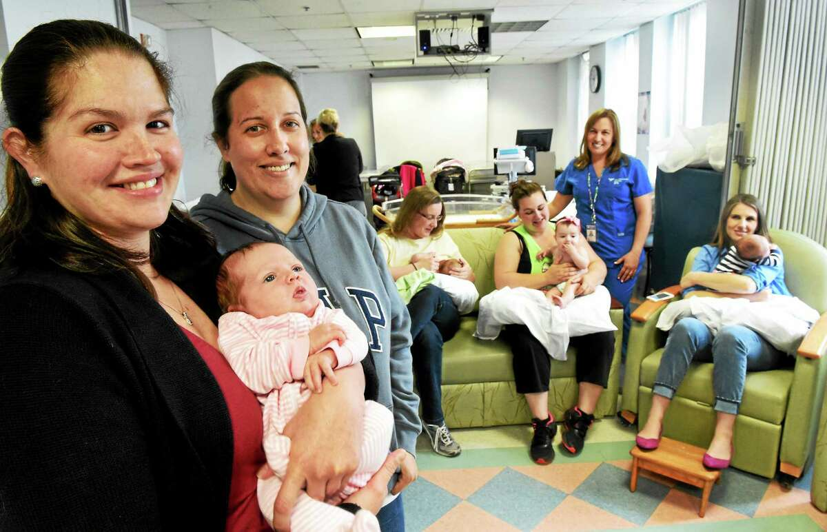 (Peter Hvizdak - New Haven Register) Megan Gerhardt of Meriden, left, and her daughter Liylah, 5-weeks, and Kate Bruce, a volunteer at the Yale-New Haven Hospital Women's Services Baby Program, second from left, want people to know that breast pumps are covered by state insurance. with mothers their babies, left to right rear, Katie Pettus of New Haven and her baby Teddy, 3-months, Nadina Juarez of Hamden and her daughter Liliana, 5-months and Lindsay Farrell of New Haven with her son Cole Brokman (CQ), 5-weeks, at the Yale-New Haven Hospital Women's Services Baby Program's Mothers Breast Feeding Support Group at the St. Raphael campus with BABY program coordinator Irene Cullagh and Lactation Specialist Irene Cullagh, R.N., I.B.C.L.C. standing rear. Tuesday June 2, 2015.