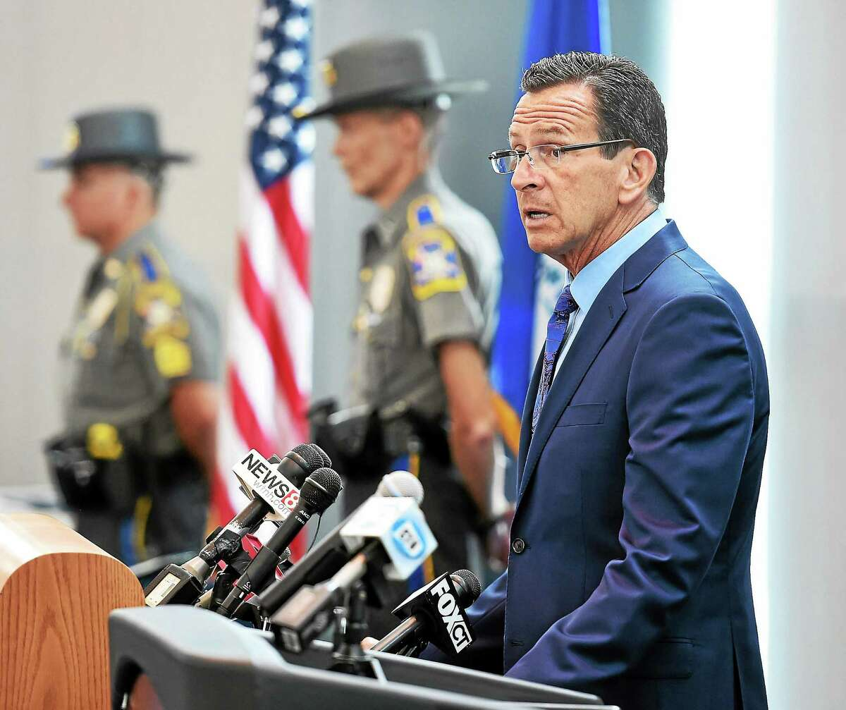 Gov. Dannel P. Malloy speaks during an awards ceremony for troopers, police, federal officers, emergency responders and civilians involved in the reponse to the Sandy Hook Elemtary School shootings in December 2012. The awards were held at Rentschler Field in East Hartford.