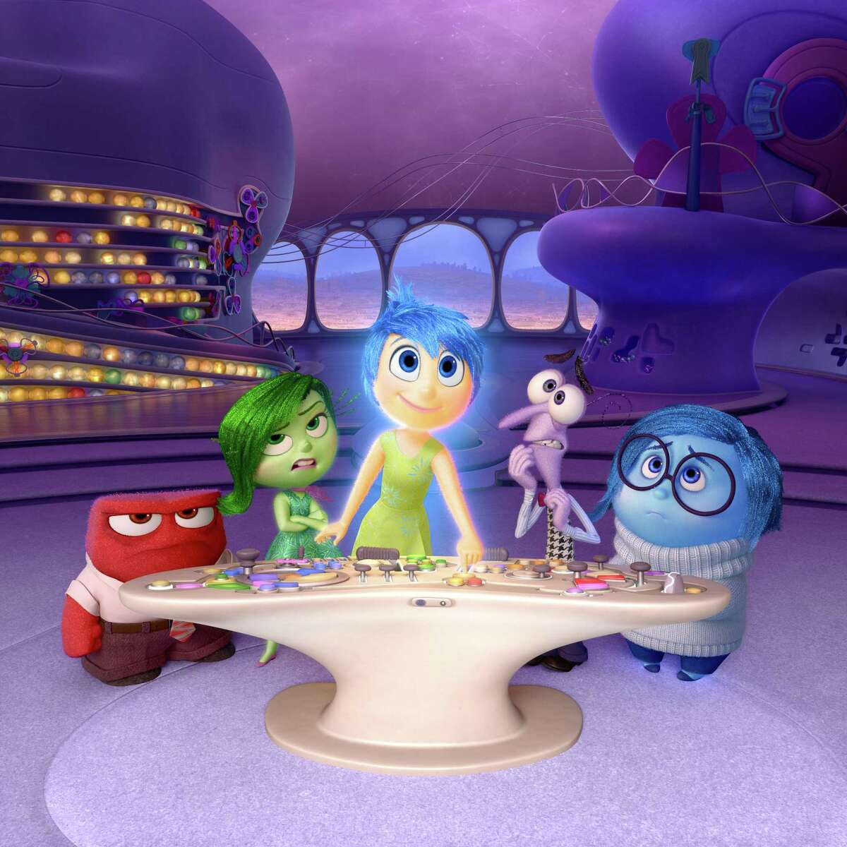 """In this file image released by Disney-Pixar, characters, from left, Anger, voiced by Lewis Black, Disgust, voiced by Mindy Kaling, Joy, voiced by Amy Poehler, Fear, voiced by Bill Hader, and Sadness, voiced by Phyllis Smith appear in a scene from """"Inside Out."""""""