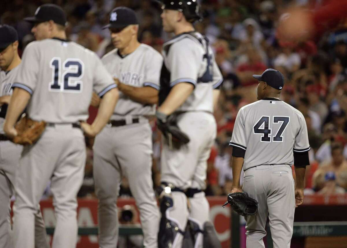 New York Yankees starter Ivan Nova, right, walks off the field after he was relieved during the sixth inning of Tuesday's loss to the Los Angeles Angels in Anaheim, Calif.