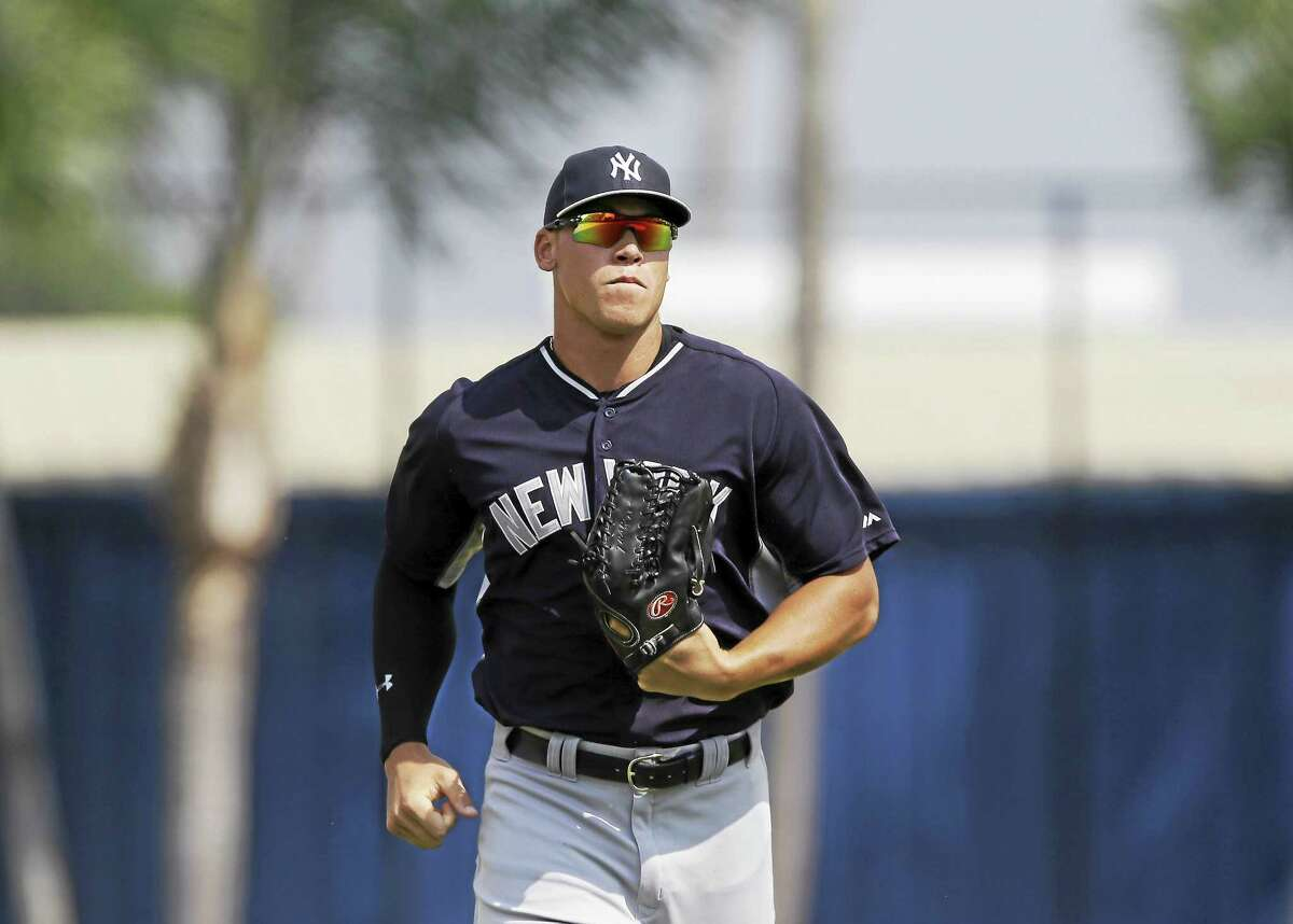 New York Yankees right fielder Aaron Judge runs to the dugout during a spring training game on March 20 in Lakeland, Fla.