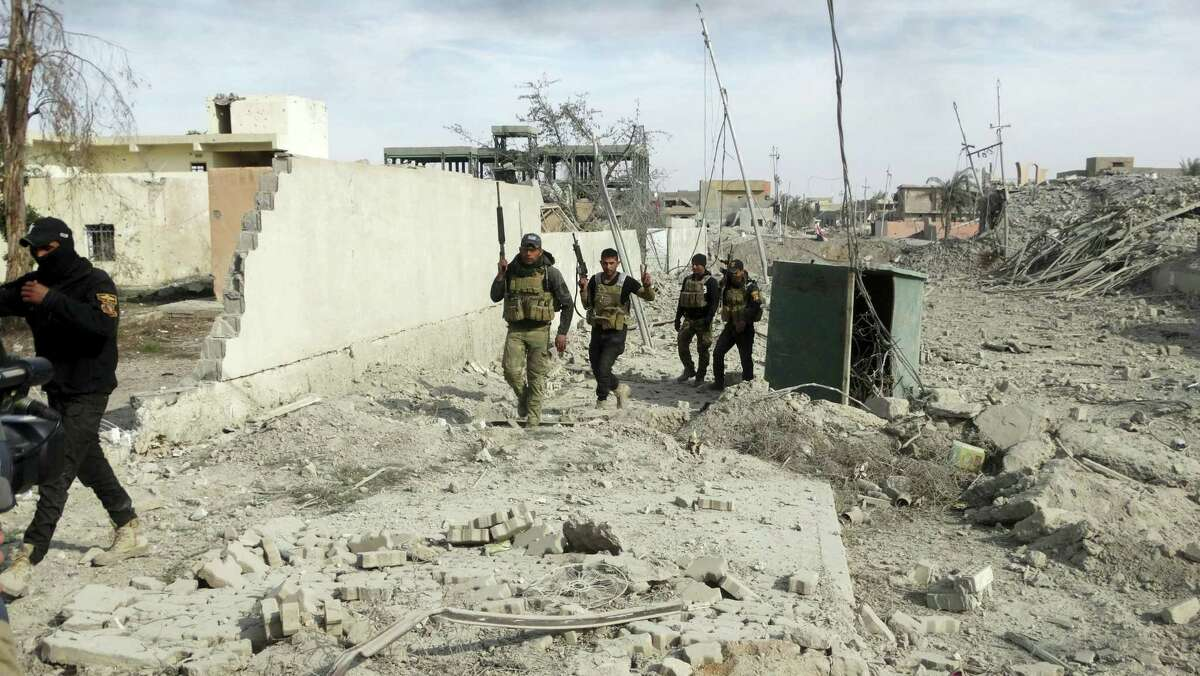 Iraqi Security forces enter the heavy damaged downtown Ramadi, 70 miles west of Baghdad, Iraq, Sunday.