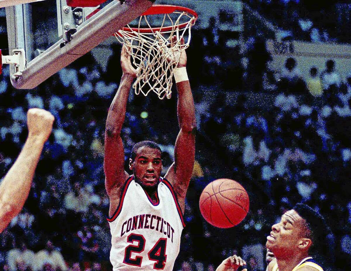 Scott Burrell, expected to be the next men's basketball coach at Southern Connecticut State, dunks the ball during UConn's second-round NCAA tournament game against California in Hartford on March 17, 1990.