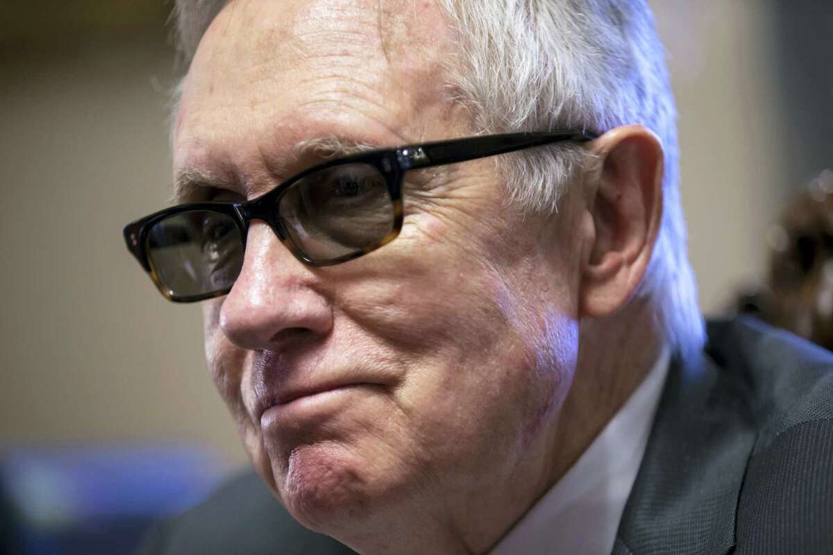 Senate Minority Leader Harry Reid of Nev. talks about the compromise process of working on the $1.1 trillion omnibus spending bill with the Republicans holding the majority in Congress during an interview with The Associated Press in his leadership office on Capitol Hill in Washington.