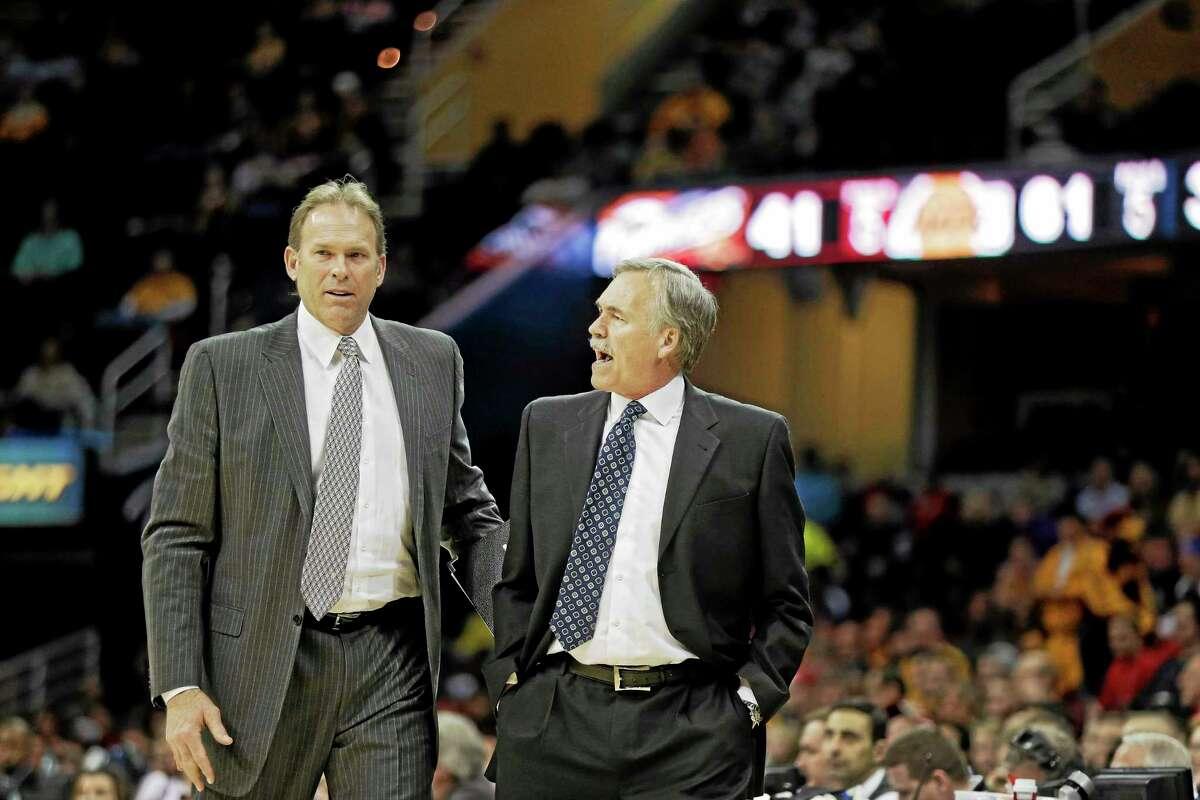 The New York Knicks have hired Kurt Rambis, left, as associate head coach.