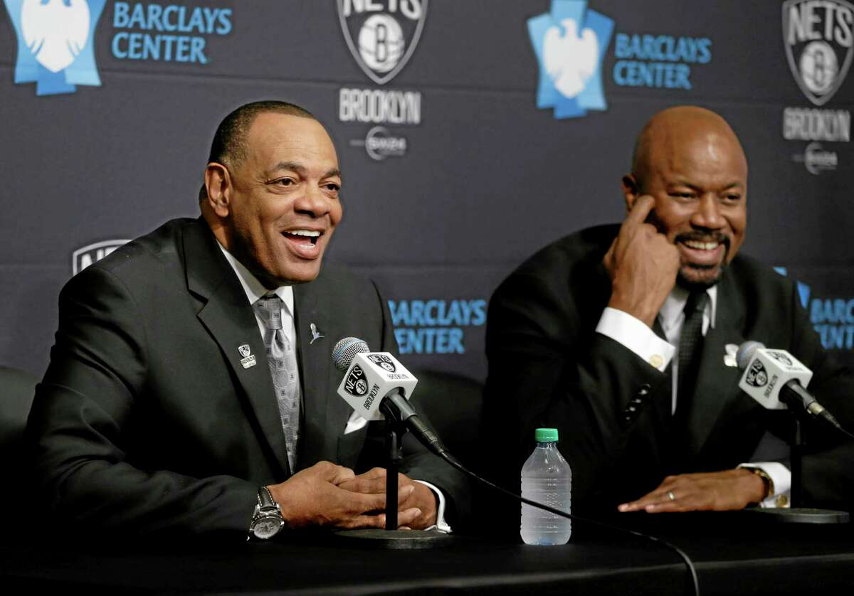 While Brooklyn Nets general manager Billy King, right, listens, Lionel Hollins speaks to the media during a news conference Monday at the Barclays Center in New York. Hollins was introduced as the team's new head coach.