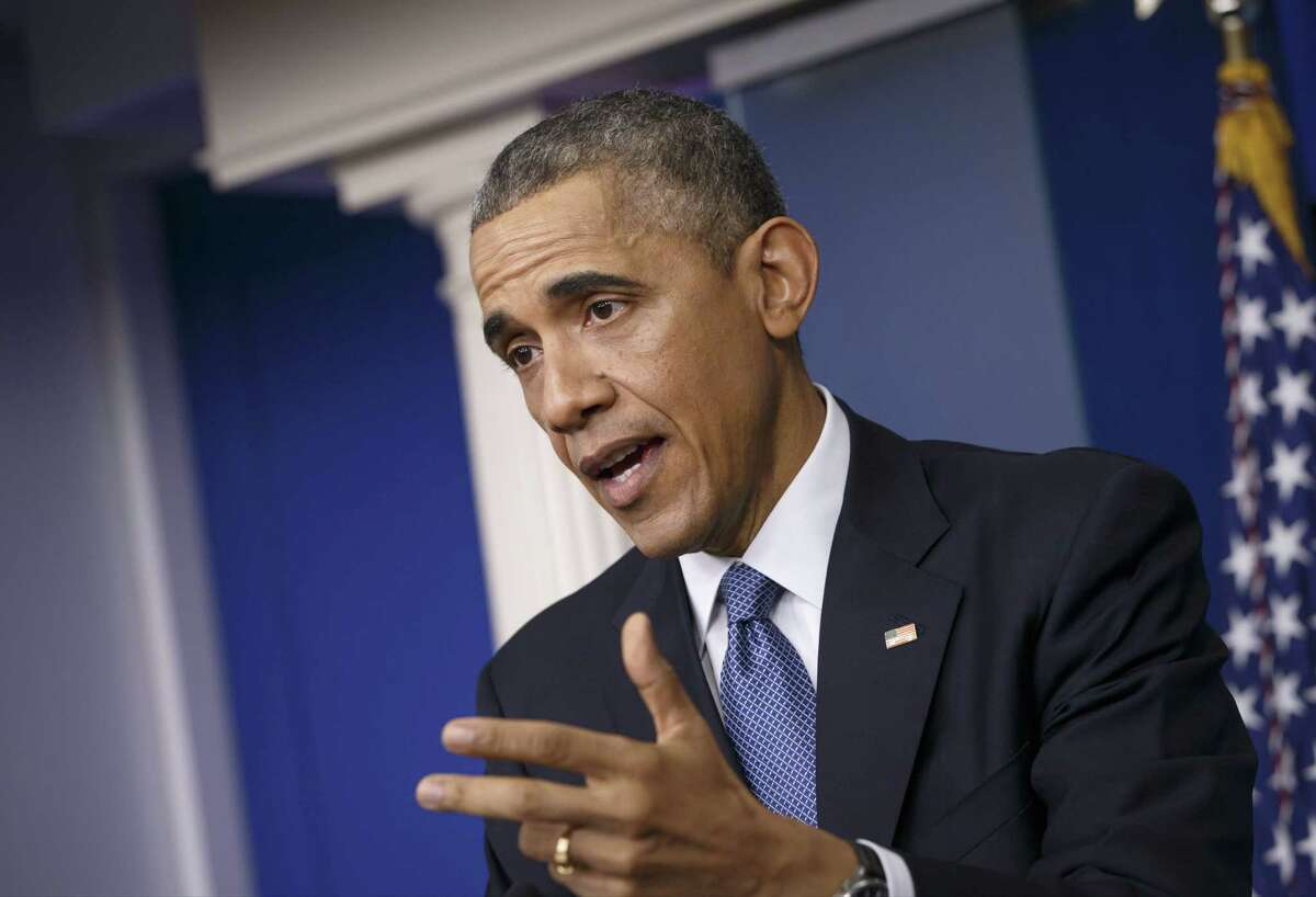 This Dec. 19, 2014 photo shows President Barack Obama as he speaks during a news conference in the Brady Press Briefing Room of the White House in Washington.