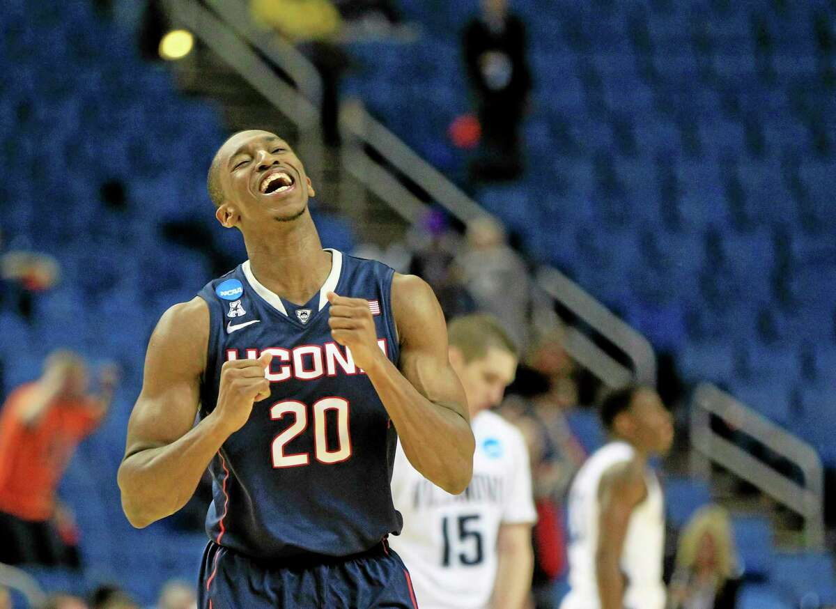 UConn's Lasan Kromah celebrates his team's 77-65 win over Villanova in the third-round game in the men's NCAA college basketball tournament at the First Niagara Center, Sunday, March 23, 2014. (AP Photo/The Buffalo News, Harry Scull Jr.)