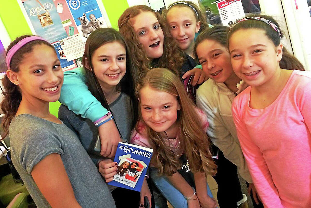 """Third from left (front row) is co-author Catia Mehring and third from left (back row) is co-author Topanga Syke Corso with their fans at Froyo for the book launch for """"#GirlHacks."""""""