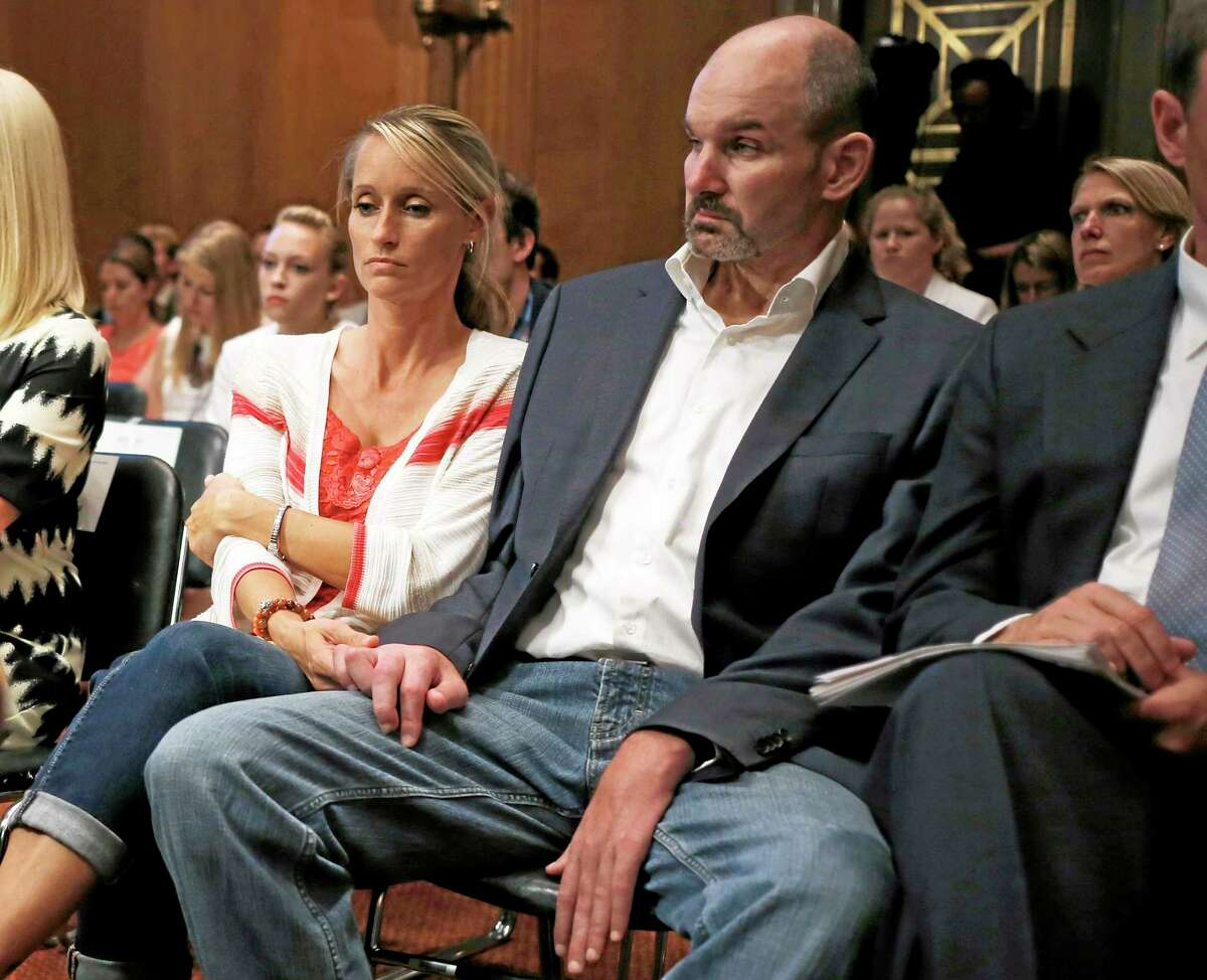 Kevin Turner, right, former NFL fullback who played for eight seasons for the New England Patriots and Philadelphia Eagles, and now suffers from amyotrophic lateral sclerosis (ALS) or Lou Gehrig's disease, listens as former professional athletes Ben Utecht, a Super Bowl-winning tight end for the Indianapolis Colts, and Chris Nowinski, a Harvard football player turned WWE professional wrestler, testify on Capitol Hill in Washington on June 25 before the Senate Special Committee on Aging hearing regarding concussions and the long term effects of brain-related sports injuries.