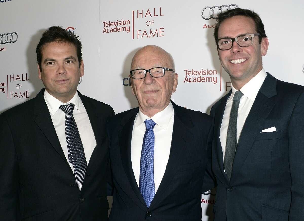 In this March 11, 2014, photo, News Corp. Exeuctive Chairman Rupert Murdoch, center, and his sons, Lachlan, left, and James Murdoch attend the 2014 Television Academy Hall of Fame in Beverly Hills, Calif.