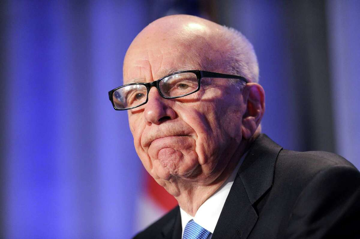 In this Oct. 14, 2011, photo, News Corp. CEO Rupert Murdoch delivers a keynote address at the National Summit on Education Reform in San Francisco.
