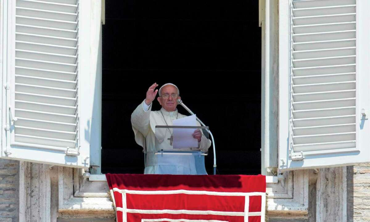 Pope Francis celebrates the Angelus noon prayer from his studio window overlooking St. Peter's Square, at the Vatican Sunday.