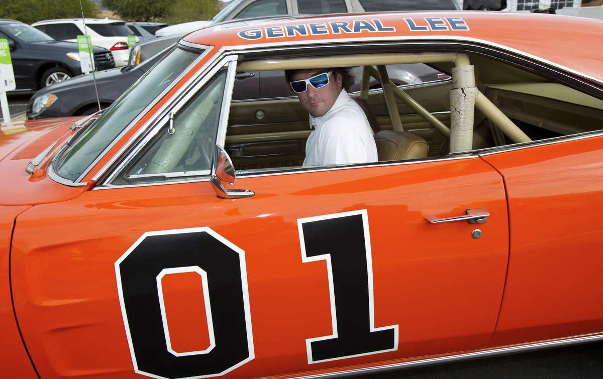 """Bubba Watson says he's painting over the Confederate flag on his car made popular in """"The Dukes of Hazzard"""" television series. Watson said Friday he'll replace it with the U.S. flag on the roof of the """"General Lee 01."""""""