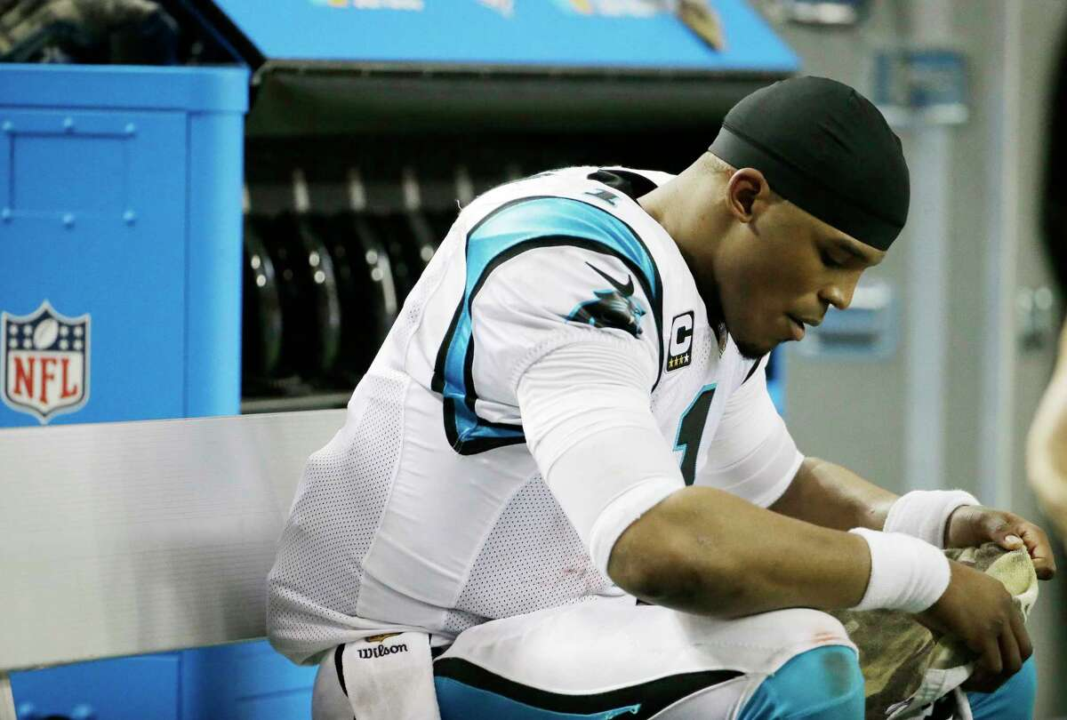 Panthers quarterback Cam Newton sits on the bench in the closing seconds of his team's loss to the Falcons on Sunday.