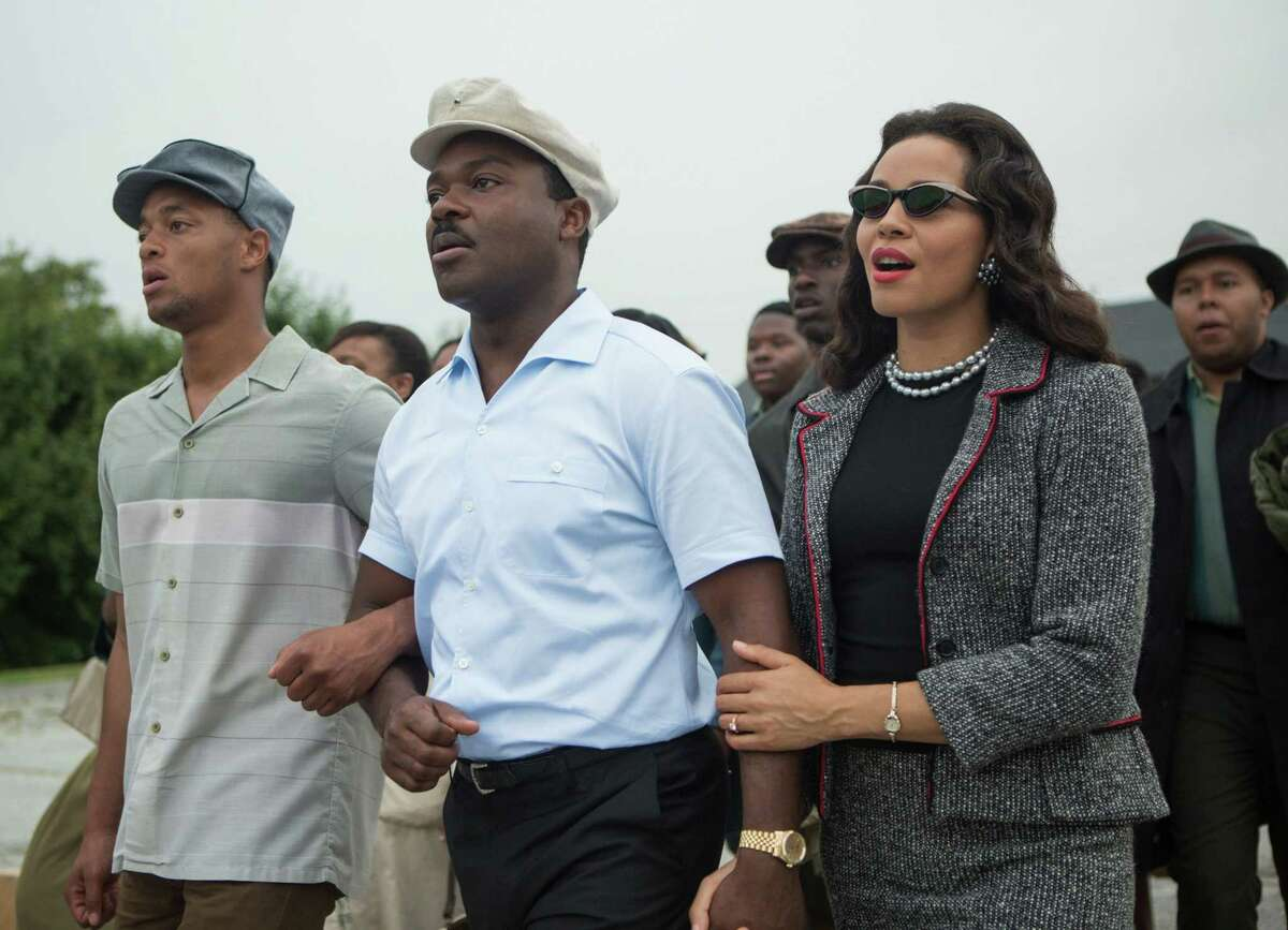 """This photo released by Paramount Pictures shows, David Oyelowo, center, as Martin Luther King Jr. and Carmen Ejogo, right, as Coretta Scott King in the film, """"Selma,"""" from Paramount Pictures and Path."""