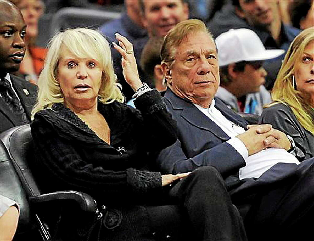 In this Nov. 12, 2010, file photo, Shelly Sterling sits with her husband, Donald Sterling, right, during the Los Angeles Clippers' NBA basketball game against the Detroit Pistons in Los Angeles. With a $2 billion sale of the Clippers hanging in the balance, a judge is set to determine Monday, June 30, 2014, if the terms of a family trust alone are enough to confirm Donald Sterling was properly removed as trustee and allow his estranged wife to sell the team without his consent.