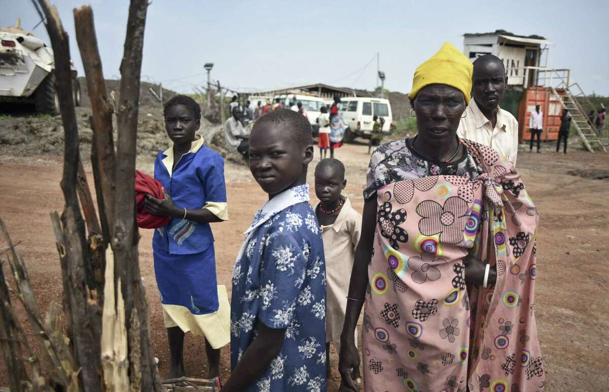 In this file photo from Friday, June 26, 2015, a displaced family arrives at the UN base in Bentiu, South Sudan.