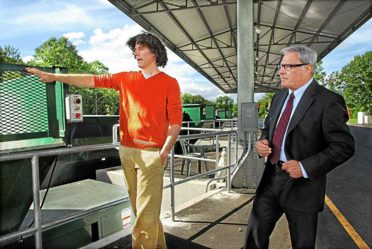 Kevin Grindle, a landscape architect with Anchor Engineering in Glastonbury and former First Selectman Paul J. DeStefano discuss the advantages at the new Haddam Transfer Station at 750 Saybrook Road in this file photo. DeStefano died Dec. 26 at age 73.