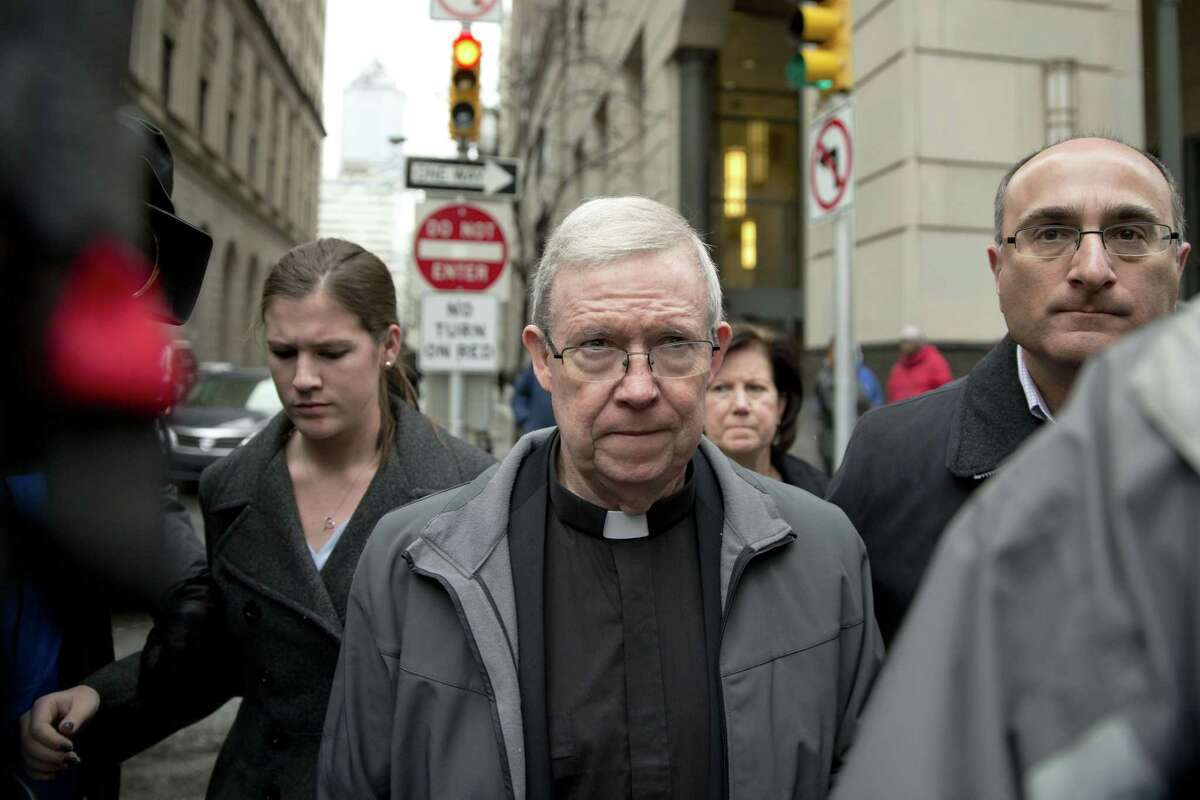 In this Jan. 6, 2014 file photo, Monsignor William Lynn walks from the criminal justice center after a bail hearing in Philadelphia. Lynn, a former church official jailed for his handling of priest sexual-abuse complaints, is housed in a Philadelphia prison that Pope Francis plans to visit during his U.S. trip. (AP Photo/Matt Rourke)