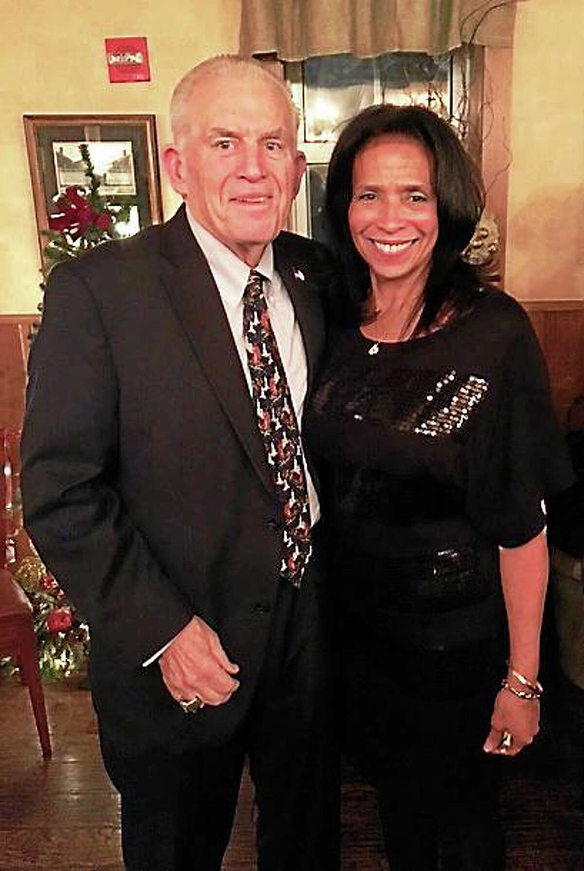 Chamber President Larry McHugh and Sterling Realtors President Jackie Williams celebrate Sterling's 30 years in business at the company's Christmas gathering Dec. 22.