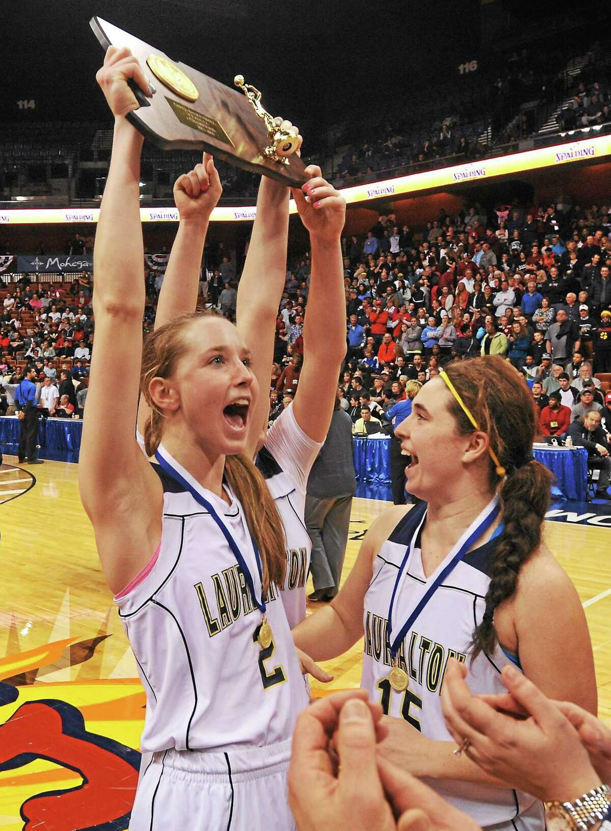 Emma McCarthy, left, Maureen Connolly and Lauralton Hall beat South Windsor 65-53 to win the Class LL state title this past weekend.