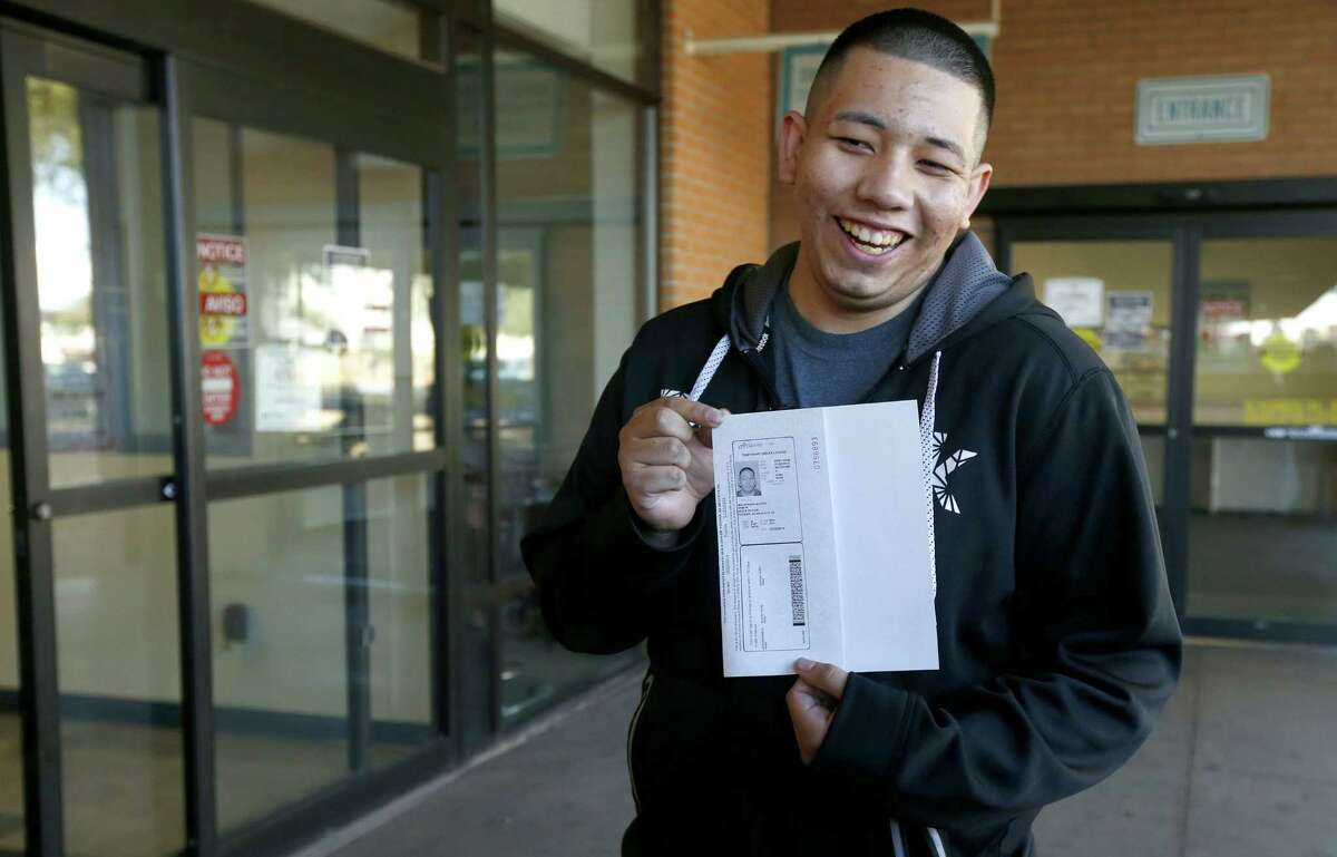 File photo Ramon Maldonado, of Phoenix, smiles as he holds up his new temporary Arizona driver's license after passing the required tests as he leaves the Arizona Department of Transportation Motor Vehicle Division office in this file photo.