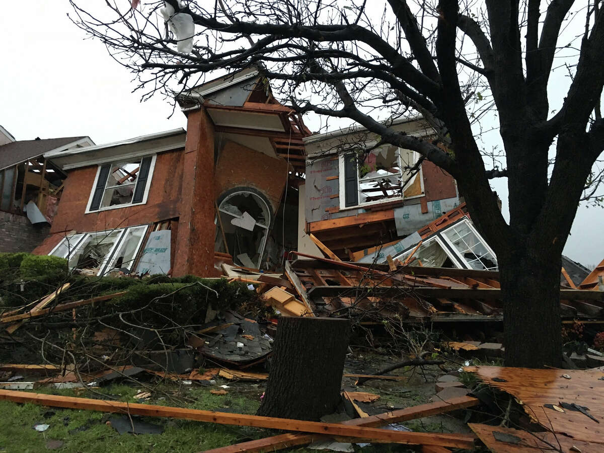 Damage of a house is seen after Saturday's tornado spread out in Rowlett, Texas, Sunday.