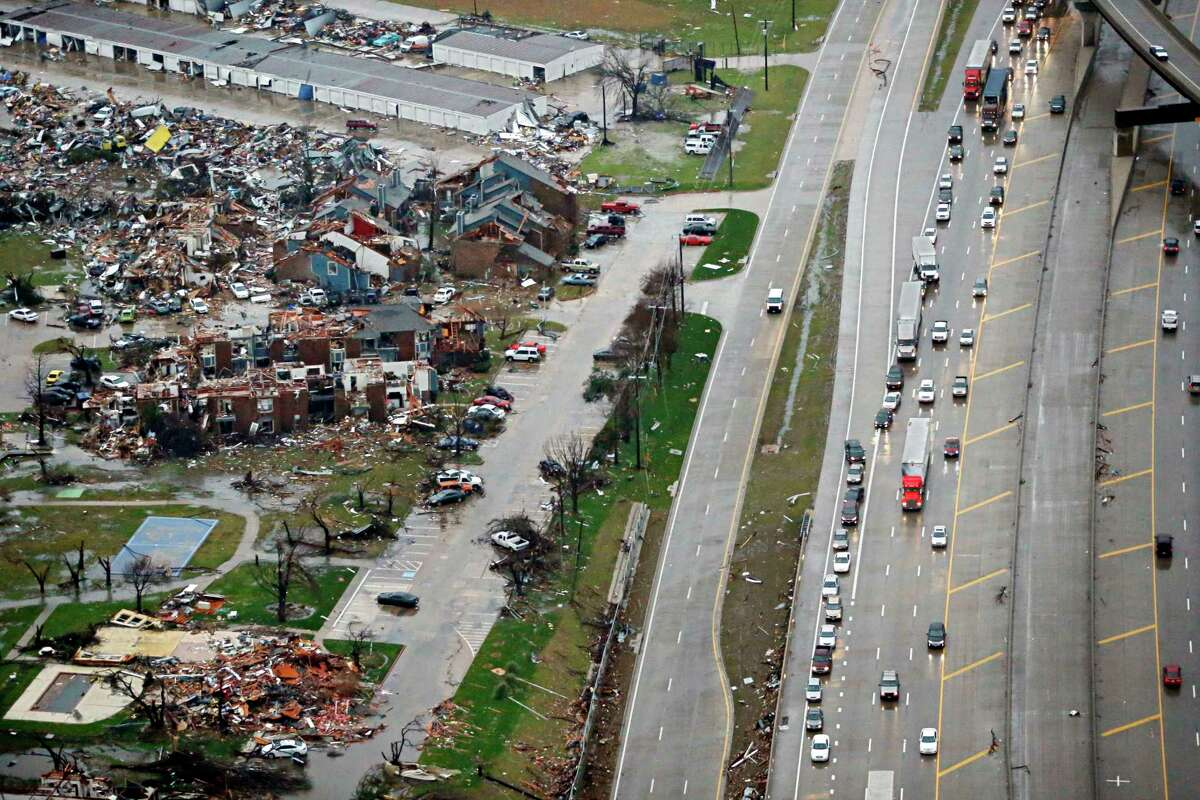 Traffic backs up along I-30, right near a site of Saturday's tornado in Garland, Texas, Sunday.