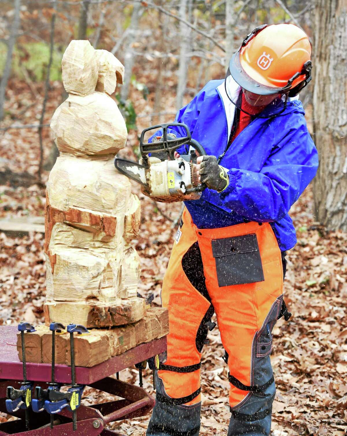 June Merwin carves an Easter Bunny in her back yard in Clinton earlier this month.