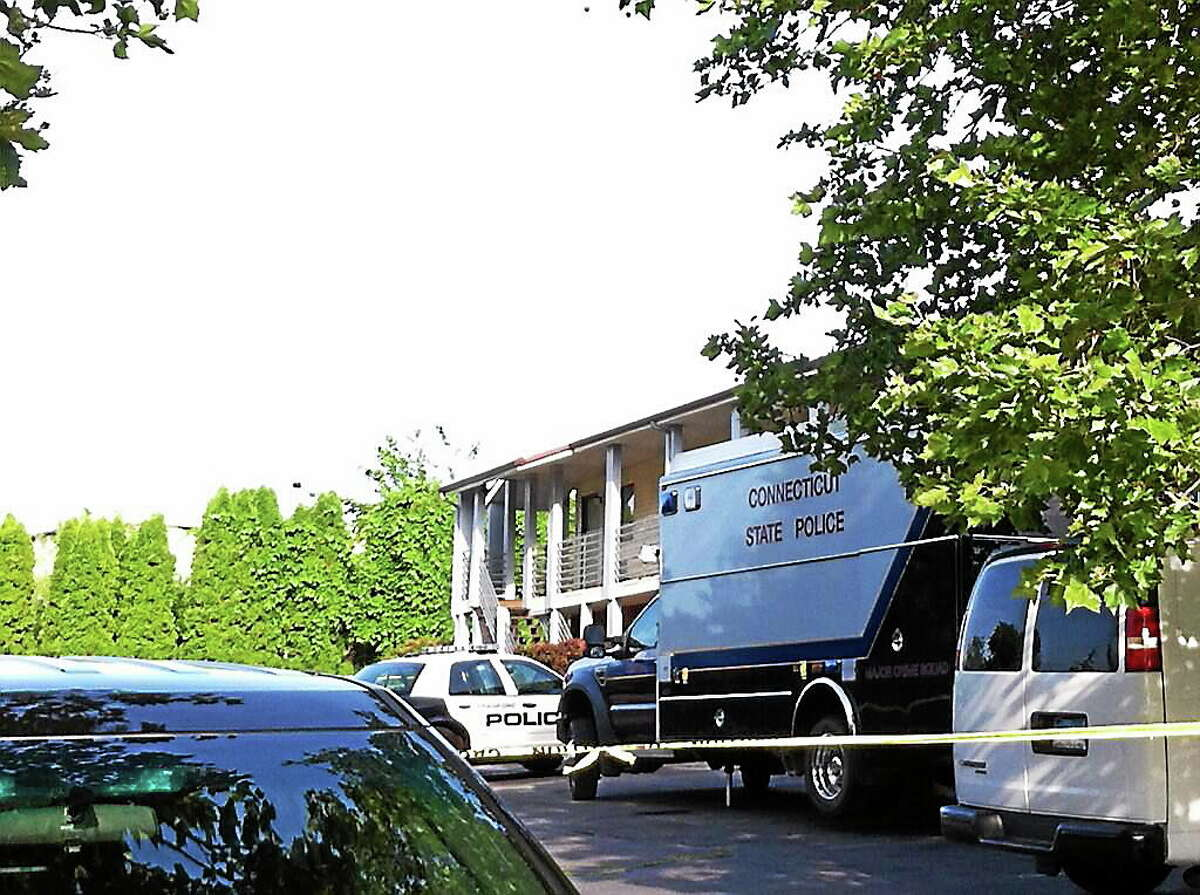 Police investigate after a man was found dead at the Branford Motel, 470 E. Main St., on Thursday. Police said Monday an arrest warrant had been issued charging a Middletown woman, Lashanda Gregory, in connection with Byron C. McDade's death.