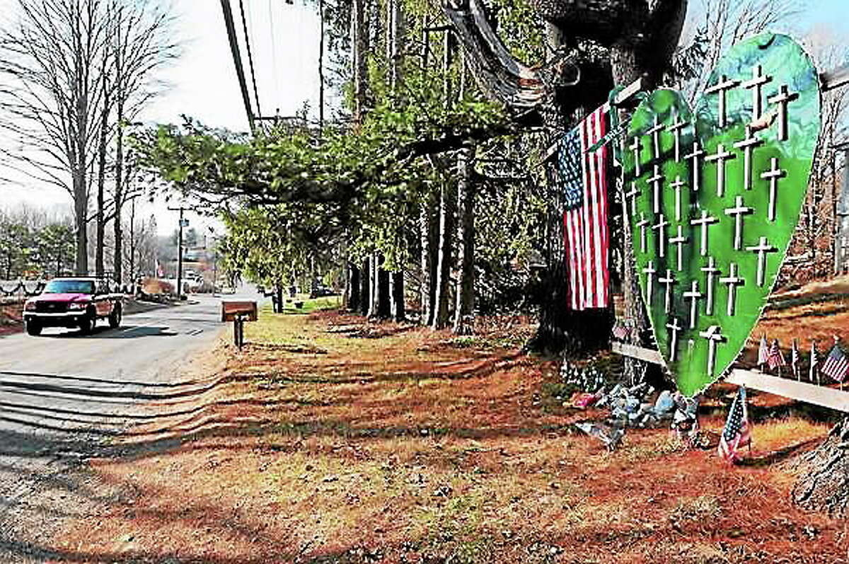 A memorial for Sandy Hook Elementary School shooting victims on Riverside Road near Dickenson Drive in Newtown in 2013.