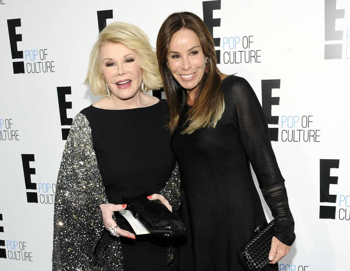 """FILE - This April 30, 2012 file photo shows comedian and TV host Joan Rivers from the show """"Fashion Police"""" and her daughter Melissa Rivers at an E! Network upfront event in New York."""
