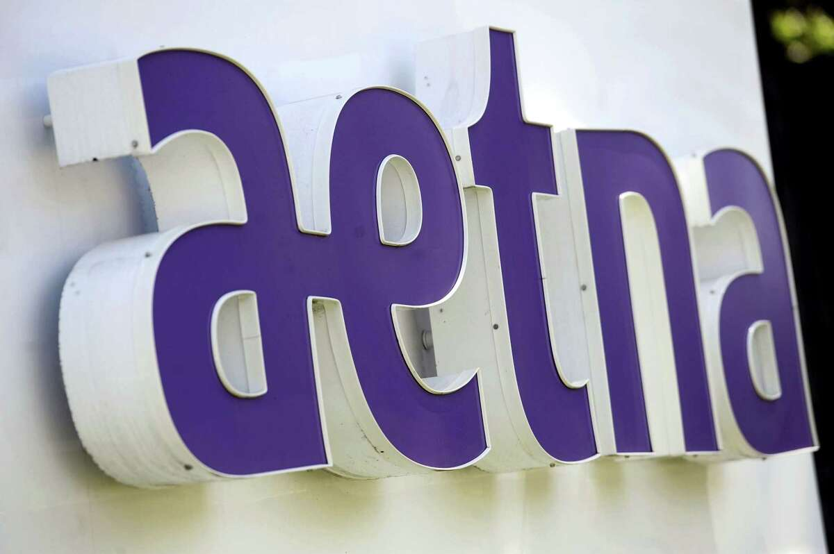 Signage in front of Aetna Inc.'s headquarters in in Hartford, Conn.