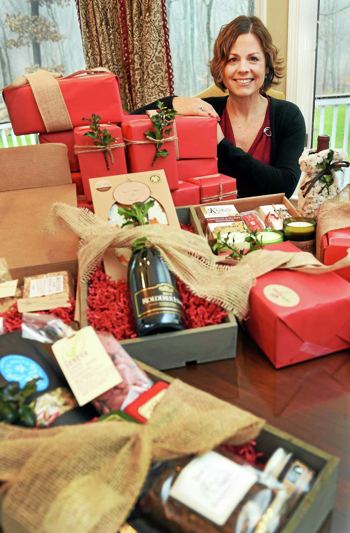 (Photo by Peter Hvizdak - New Haven Register) Alison Wehrle of Madison, owner of Red House Gifts, makes gift baskets for individuals and corporate clients with online ordering. Baskets may include everything from wine and cheese, specialty foods, to baby gifts and cocoa mix.