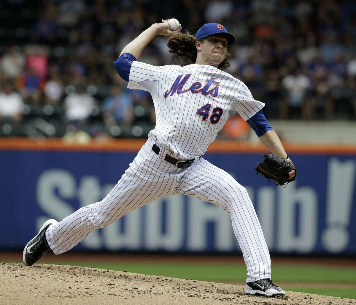 Mets starter Jacob deGrom throws during the second inning of Thursday's 6-1 loss to the Chicago Cubs at Citi Field in New York.