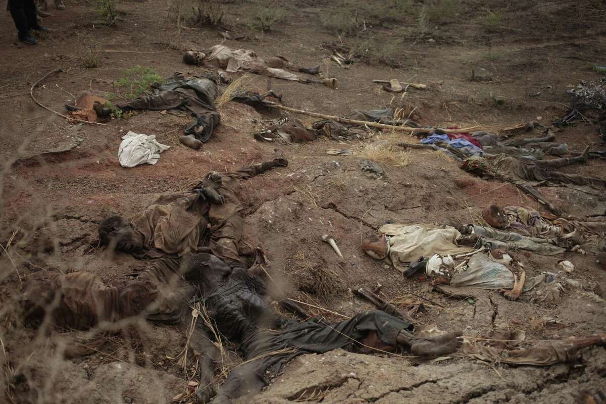 In this photo taken April 8, 2015, decomposed bodies of civilians reportedly killed by Boko Haram lie around on the ground in Gwoza, Nigeria.