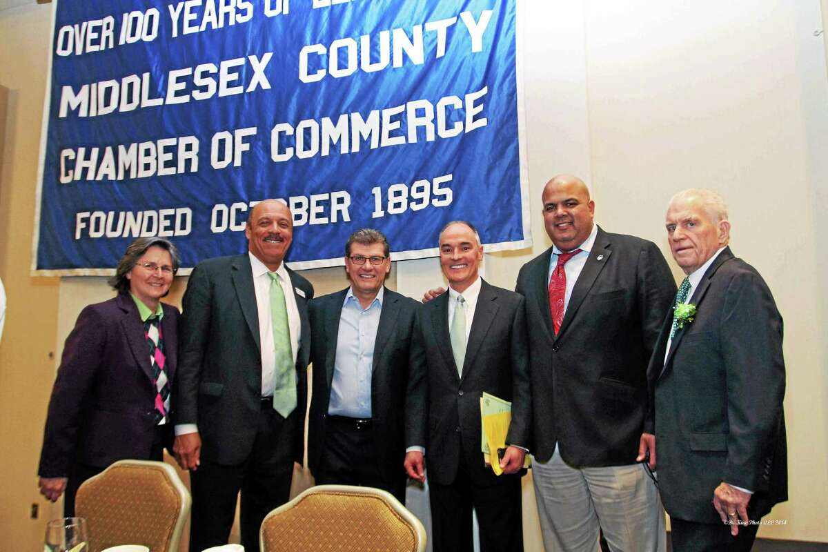 De Kine Photo LLC From left are: Chamber Chairwoman Darlene Briggs, Chamber Past Chair and Liberty Bank President Chandler Howard, UConn Womenís Basketball Coach Geno Auriemma, MiddleOak CEO Gary Vallo, UCONN Director of Athletics Warde Manuel and Chamber President Larry McHugh. Photo Credit: