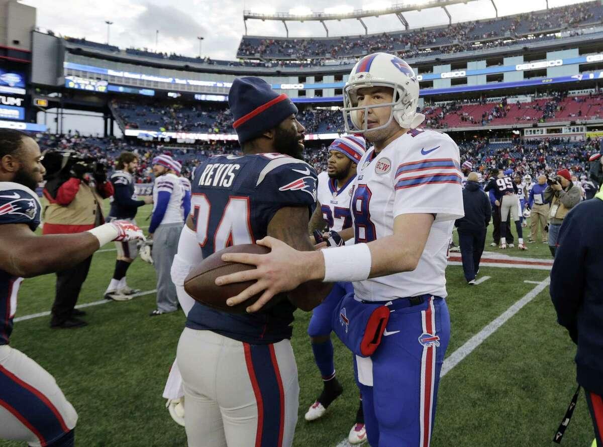 Patriots cornerback Darrelle Revis (24) and Bills quarterback Kyle Orton (18) speak at midfield after Sunday's game.
